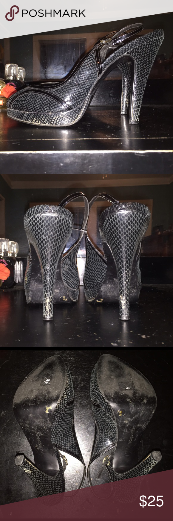 BCBG Black Snakeskin Slingback Peeptoe Heels 8 • BCBG Girls Black Snakeskin Heels in size 6.5. • Pre-owned heels are in excellent condition. Heels do show signs of wear on the bottom of soles (as pictured), heel tips, and heels do have minimal scuffs (as pictured). Inner shoe is cleans and heels do not have any smells! • Heels feature a black snakeskin print, Slingback strap, and a peep toe front with Art Deco inspired trim. (as pictured) • A true size 8 BCBGirls Shoes Heels