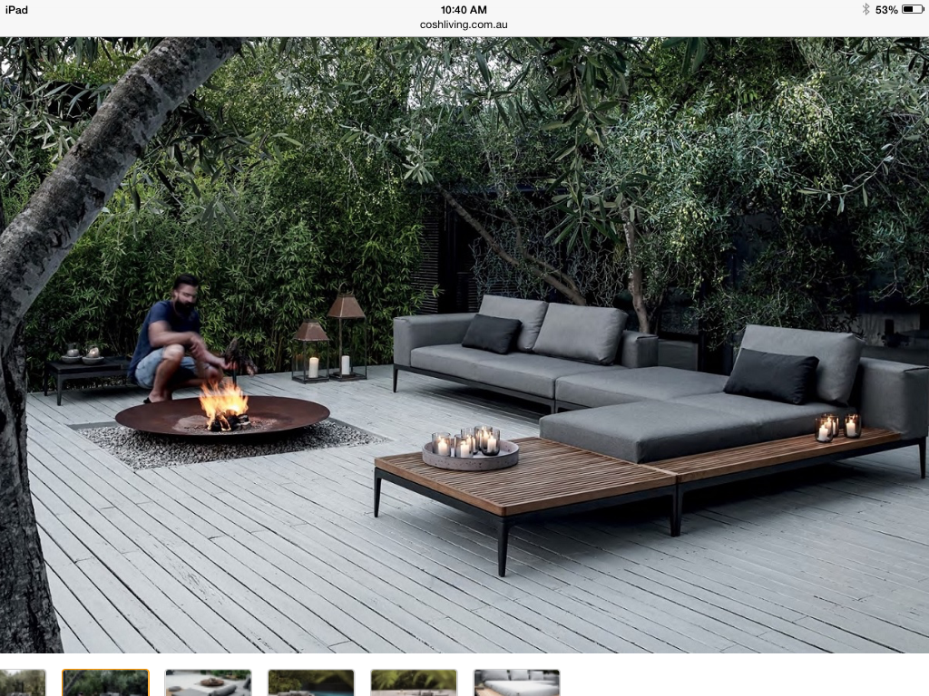 Attractive fire bowl on inset gravel on a charming weathered deck.