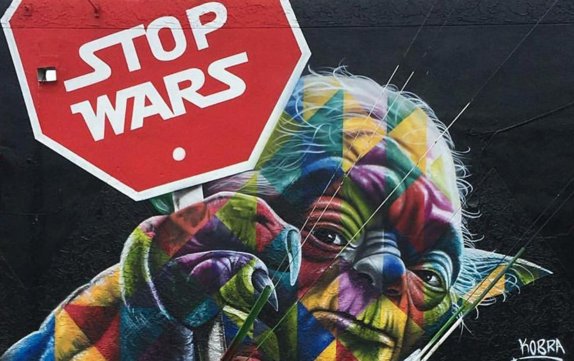"""Artist Eduardo Kobra, well known in the street art scene for his massive, colorful murals, turned Yoda from Star Wars into an activist for peace, holding a stop sign written with the movie's iconic font. """"Stop Wars,"""" the sign reads. It is one of the most moving pieces of art works released in Miami."""