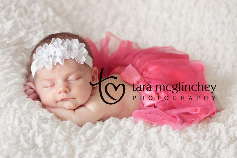 Newborn girl photography ideas newborn baby girl in pink tutu smiles for nj newborn photographer