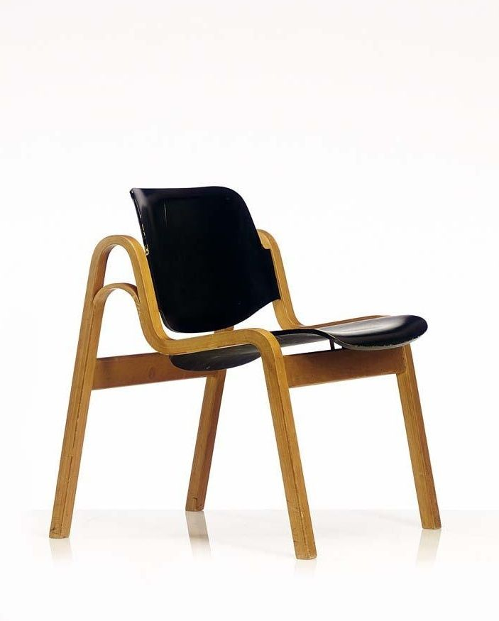 Wilhelmiina, a plywood stacking chair designed by Ilmari Tapiovaara for W. Schauman, Finland  designed 1959 beech faced plywood frame with an ebonised plywood seat and backrest marked with plastic sticker 'Finland' height 68 cm