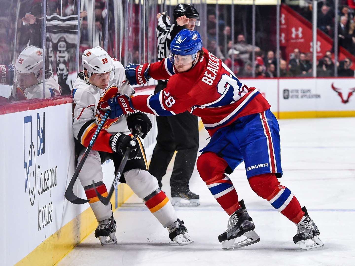 Getting board:   Nathan Beaulieu, right, of the Montreal Canadiens pins Alex Chiasson of the Calgary Flames against the boards on Jan. 24 at the Bell Centre in Montreal. The Canadiens won 5‐1.