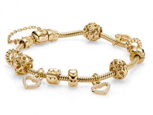 Extravagant 14ct Gold Pandora Bracelet - Gold Moments Charm