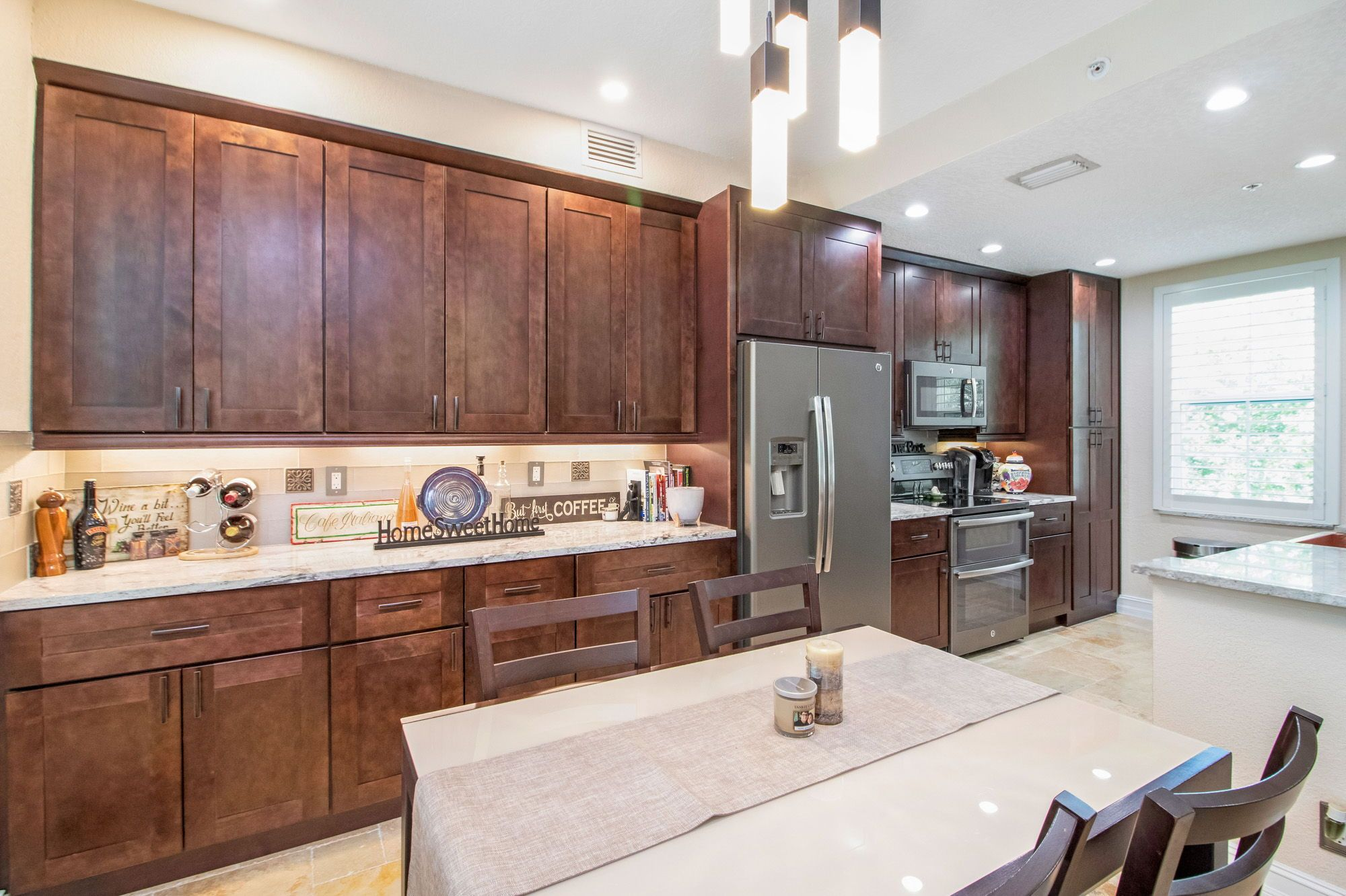 The Kitchen Is Open Concept And Has Cherry Wood Cabinets Granite