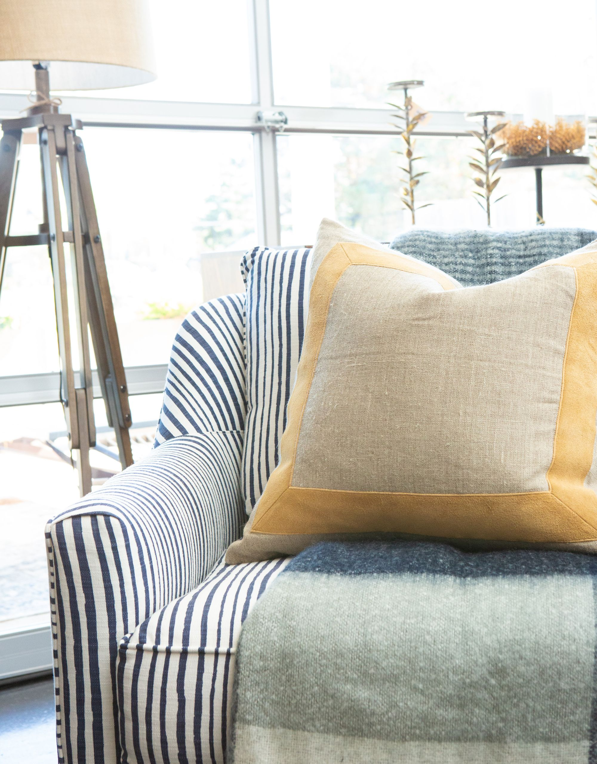Coastal navy and blue striped swivel chair with images