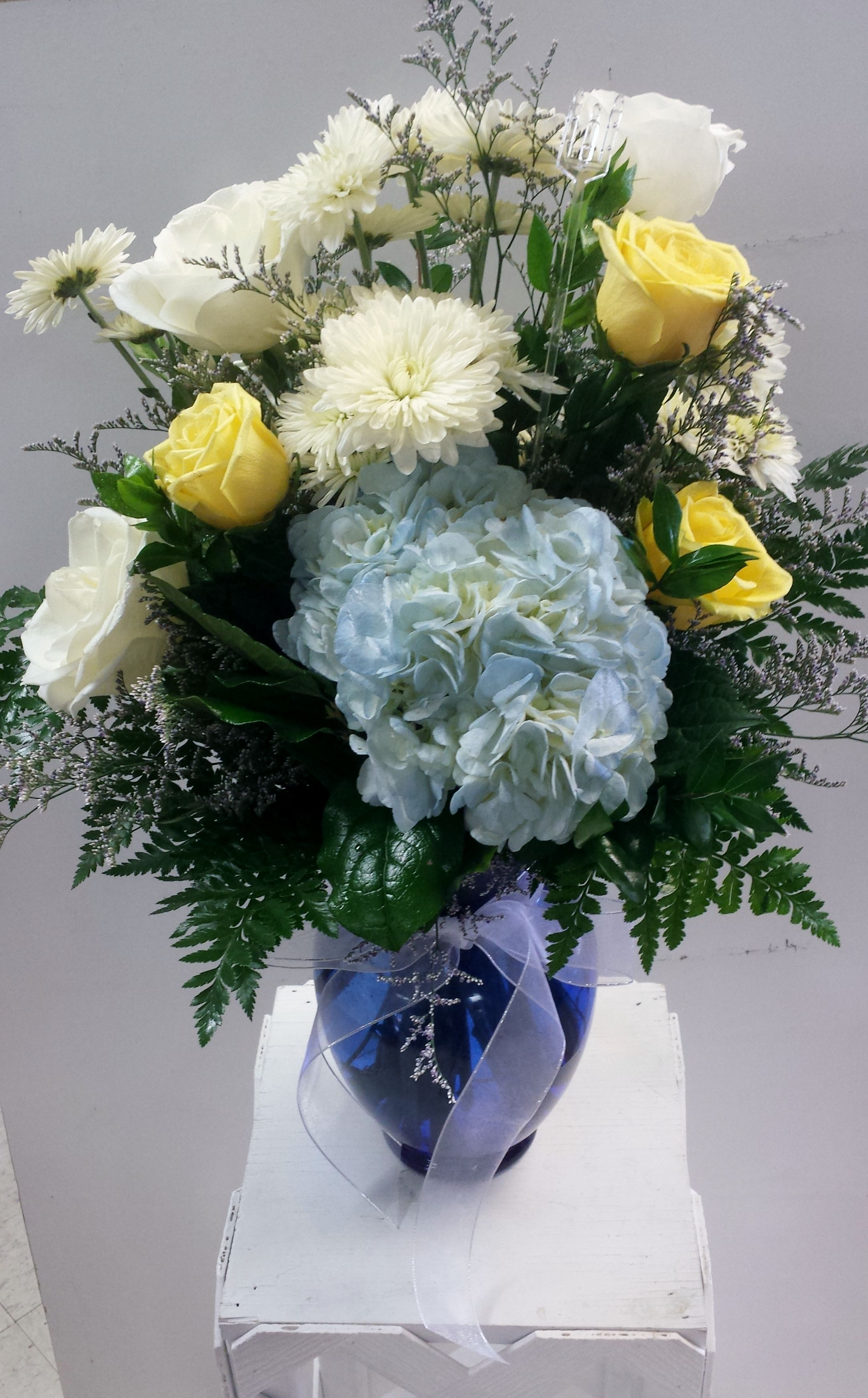 Beautiful Blue And White Arrangements With Pops Of Yellow Roses