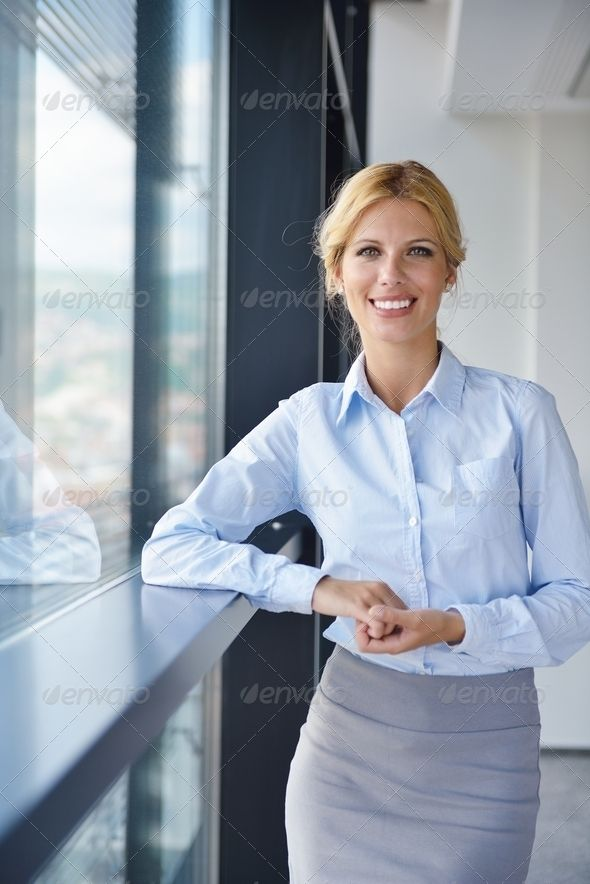 Business Woman With Her Staff In Background At Office Adult