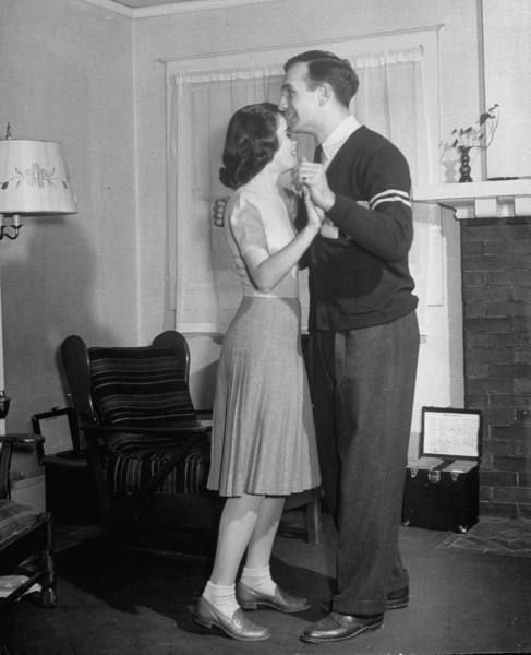 Michigan halfback Tom Harmon and girlfriend Margot Thoms dancing to phonograph record. 1940.