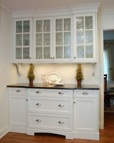 Built In Style Kitchen Buffet. White Cabinets With Black Countertop