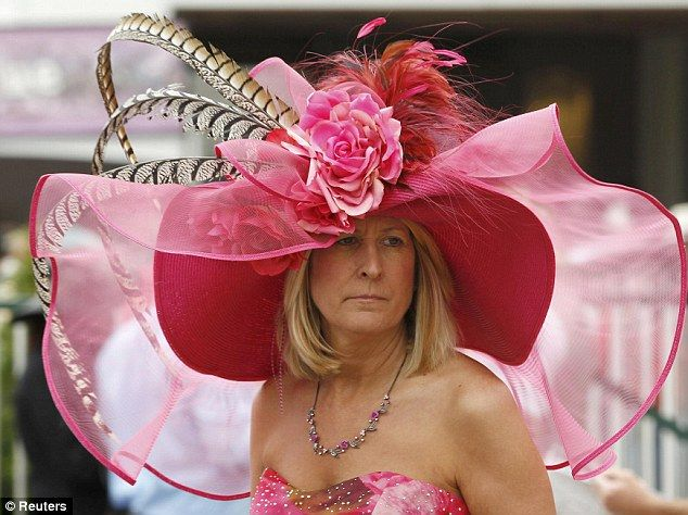 So much for the dainty fascinator  A racing fan looks slightly weighed down  by her elaborate hat at the Churchill Downs as she waits for the Kentucky  Derby ... e5813cc2e9a