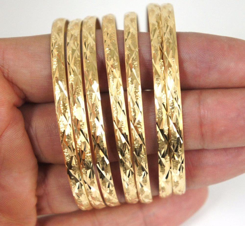 dc59bb2b5b662 Diamond Cut Ladies 7 Day Semanario Bangle Bracelet in 14k Yellow ...