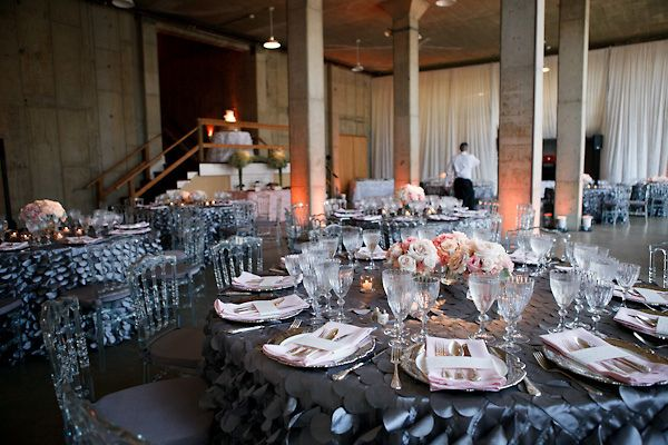 Modern-vintage mix: black tablecloths, ghost chairs, and pink centerpieces by Holly Heider Chapple Flowers/Peter Bang Photography