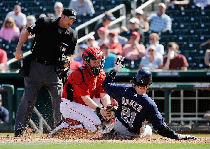 John Baker of the San Diego Padres scores a run on a double by teammate Rymer Liriano