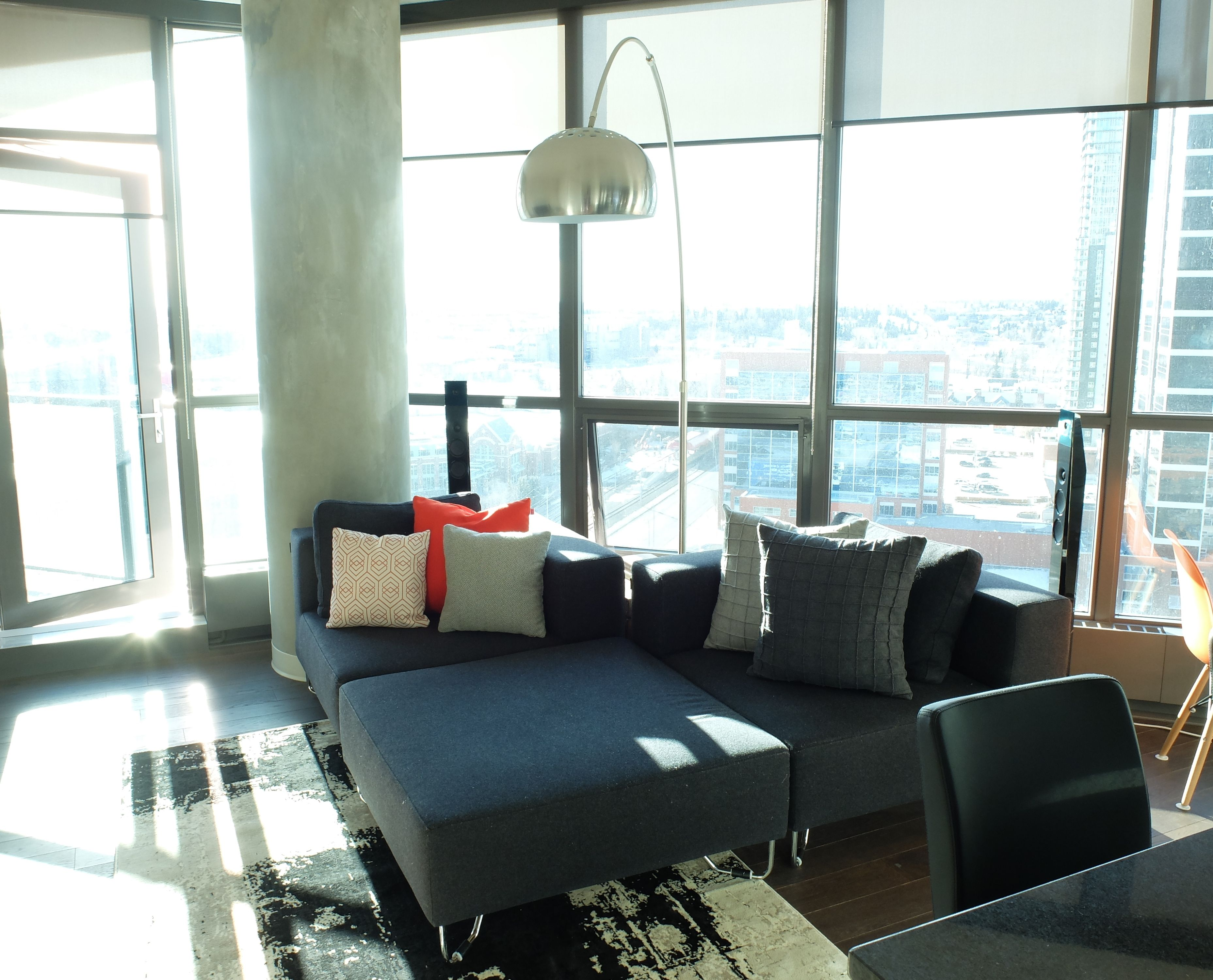 Modern Condo Living Room With Gray Low Profile Sectional And Overhang Lamp Lux Design