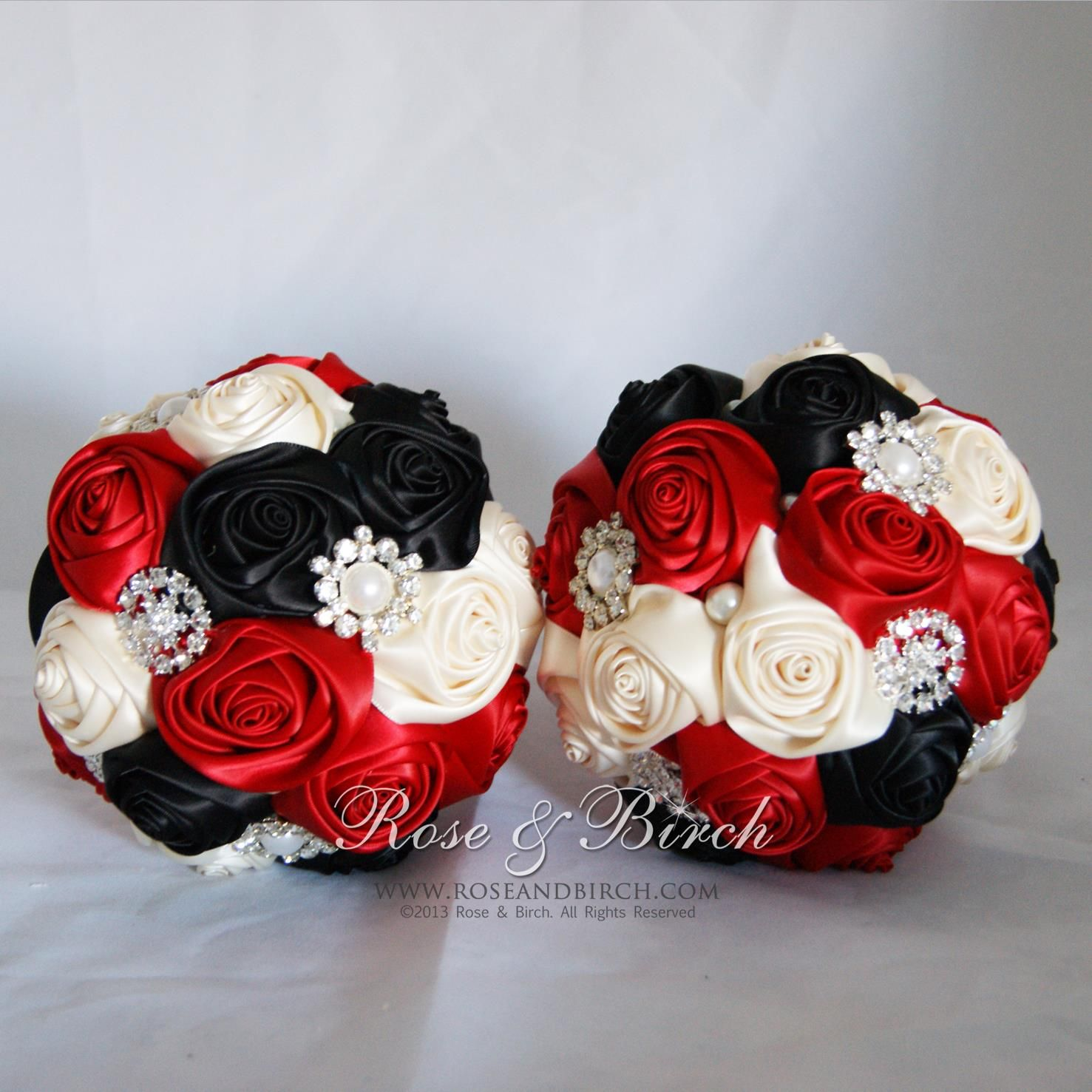 Small sized bridalwedding bouquets in red black and ivory with