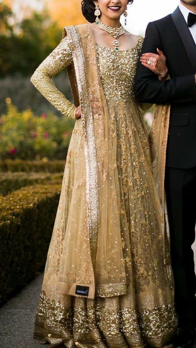 Awesome Gold toned gown looks really elegant for a Indian wedding reception