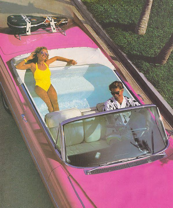 summer time - pink car - swimming pool - couple having fun