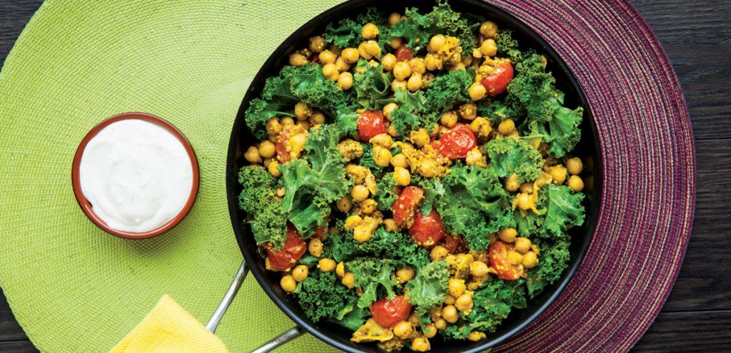 Infused with Indian flavour and nutrient-packed kale, this skillet dish proves that sometimes simple is best. If some of the garlic and spices stick to the skillet by the time you have added the final ingredients, pour in a small amount of broth or white wine to help scrape up the flavourful bits.