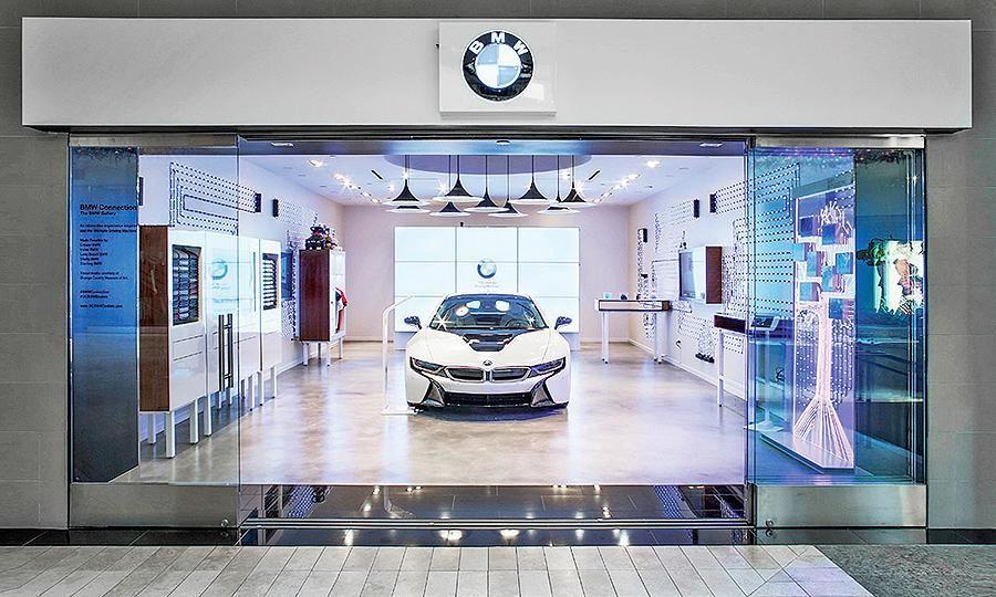 Bmw Pop Up Stores Part Of The Bmw Future Retail Program Car Showroom Design Pop Up Stores Car Showroom Interior