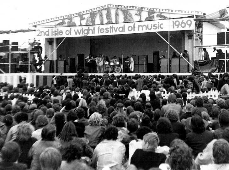 8-30 in 1969: The second annual Isle of Wight Festival takes place in England just two weeks after the triumphant Woodstock concert, featuring Bob Dylan, The Who, The Band, Joe Cocker, Free, Richie Havens, The Moody Blues, The Nice, Tom Paxton, Pentangle and The Pretty Things. The Who is on stage in this photo.