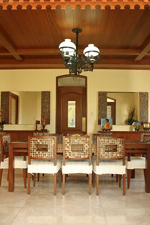 In The Adjoining Dining Room The Look Is More Unified The Wooden