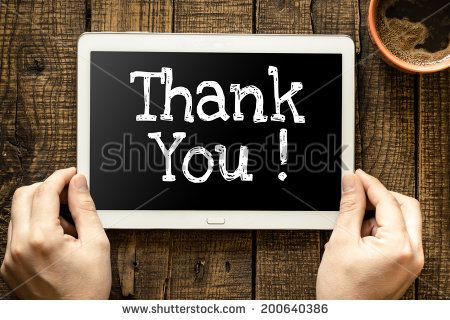 "Tablet pc with text ""Thank You"" which holding man"