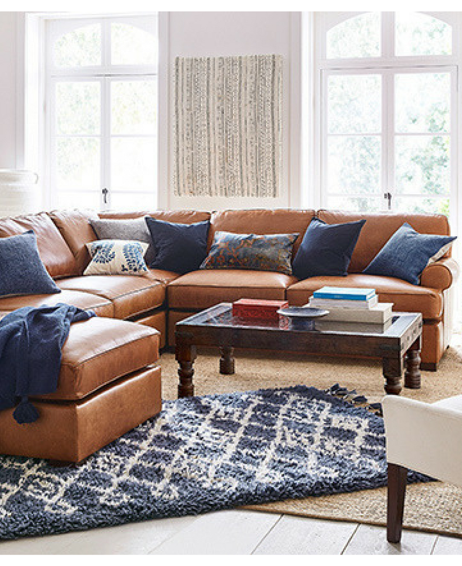 I'm loving this tan + navy living room! This leather L ...