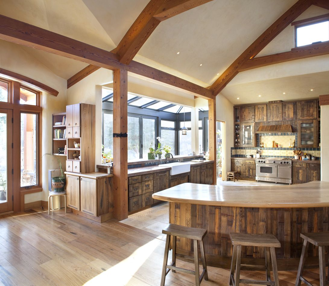Are you not flumoxed that this is made of straw??? And the cabinets-- pickle barrels. Timberframe & Strawbale Home in Old Snowmass | Strawbale Construction in Colorado | Land + Shelter