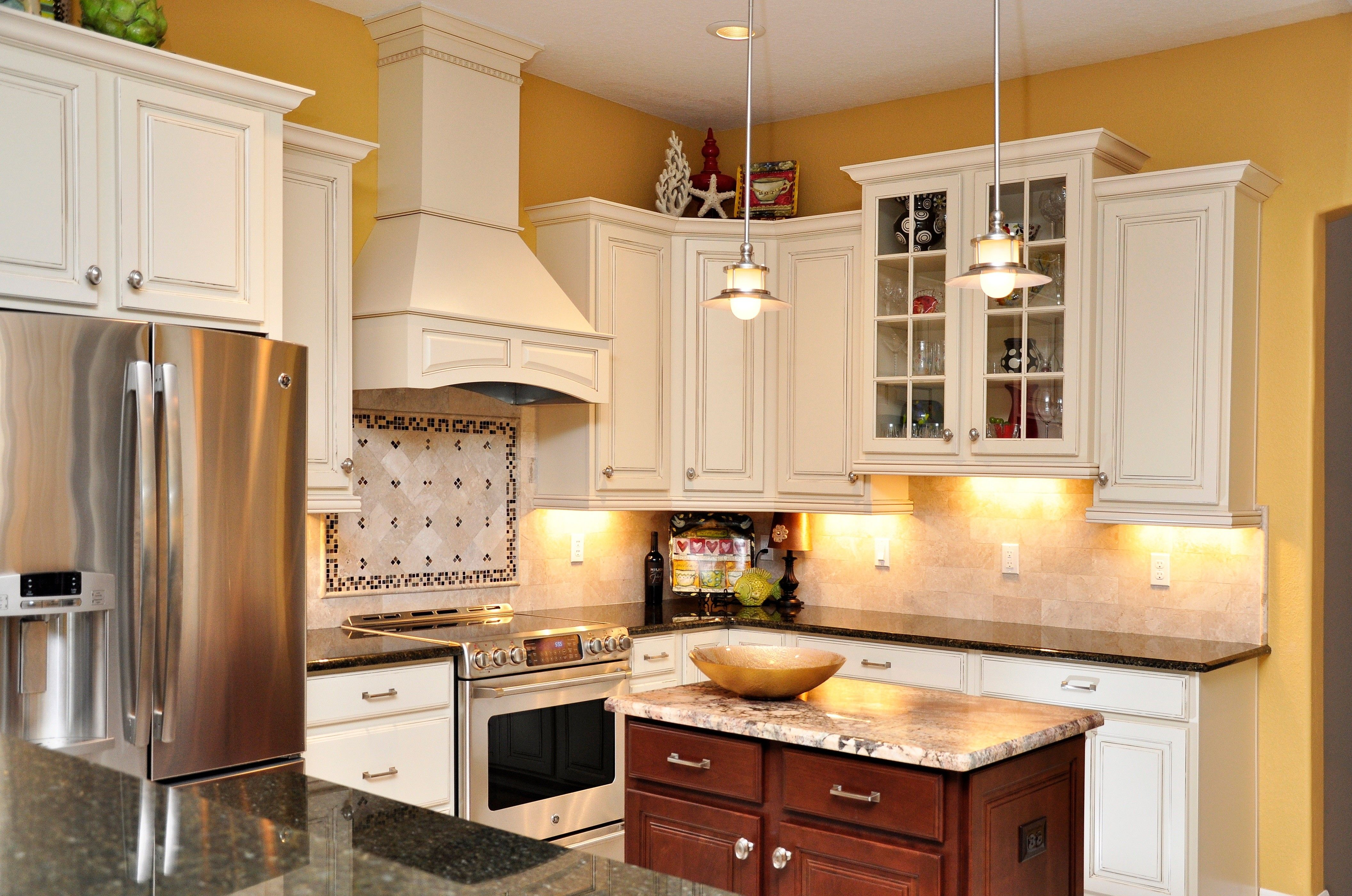 White Cabinets Dark Granite Stainless Steel Appliances Custom Tile Backslash Yellow Kitchen By The Best Cu Kitchen Remodel Yellow Kitchen Kitchen Colors