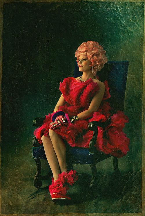 Effie's back! Here's the first portrait to advertise Capitol Couture. Looking fierce, Effie.