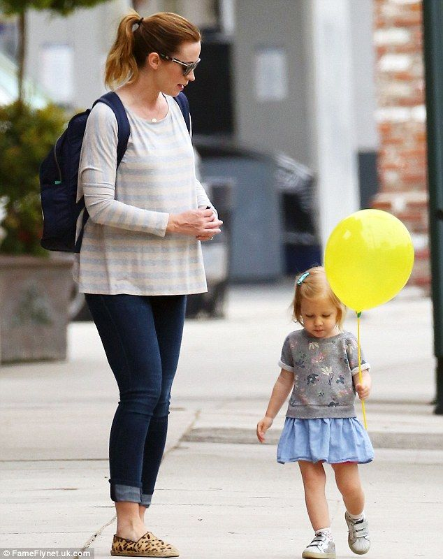 Stylish like mom: The two-year-old tot wore a blue skirt and floral print top