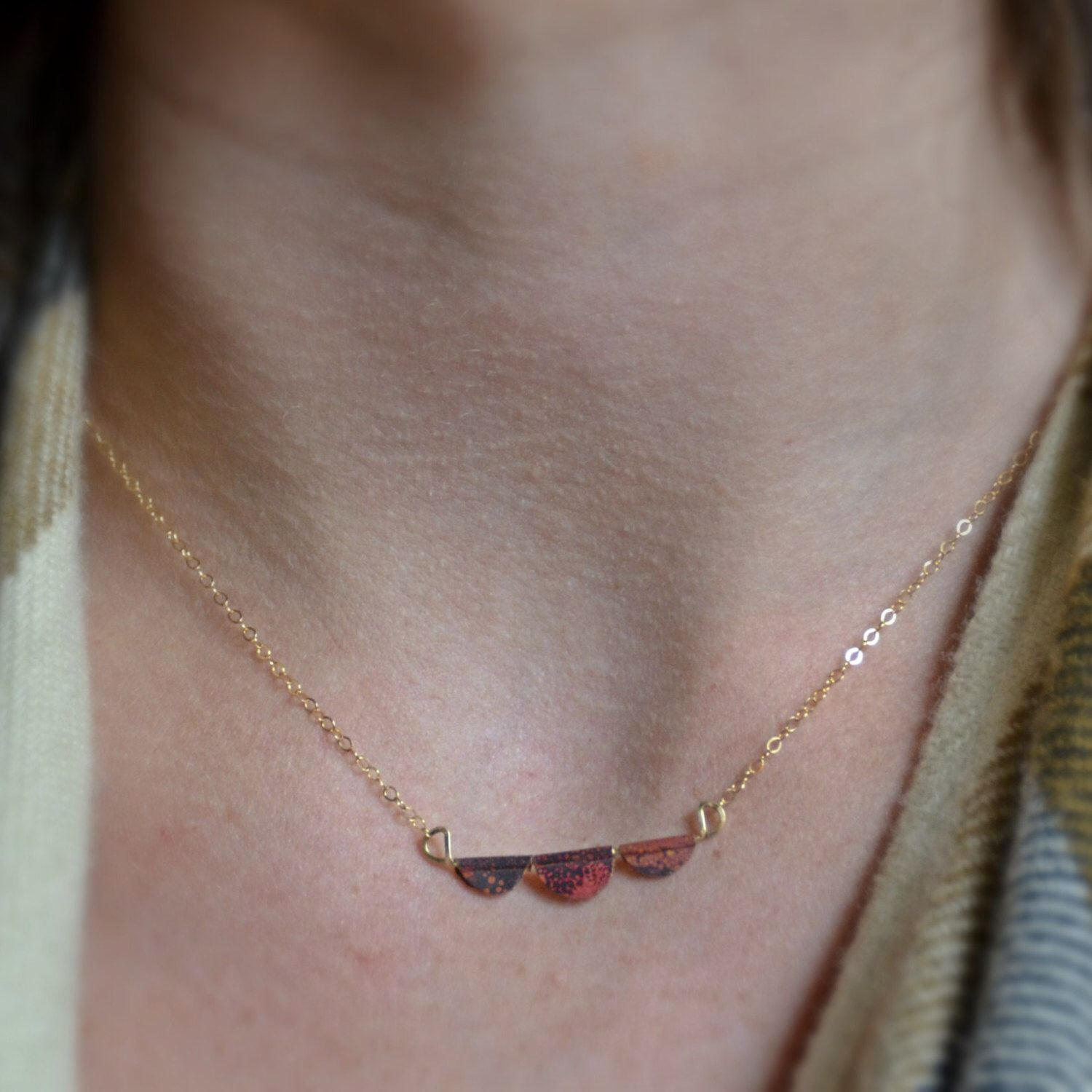 A personal favorite from my Etsy shop https://www.etsy.com/listing/474409000/fire-painted-copper-petal-necklace-cute