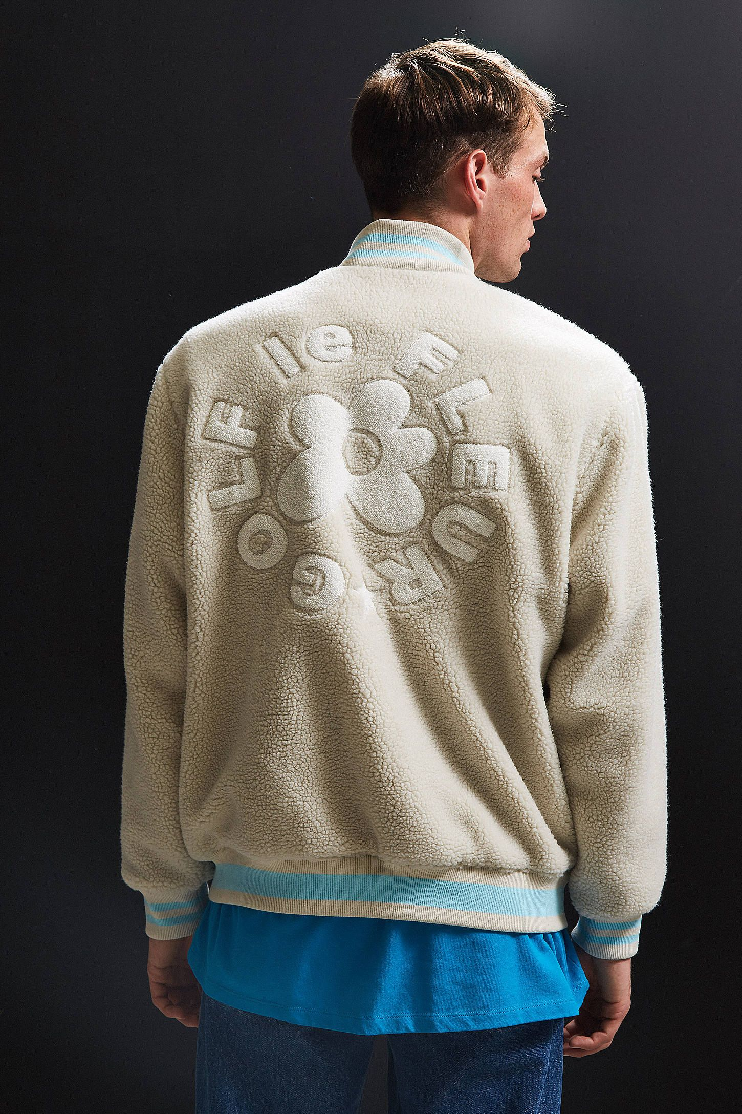 72ca15e6fff4 Shop Converse X Golf Le Fleur Sherpa Varsity Jacket at Urban Outfitters  today. We carry all the latest styles