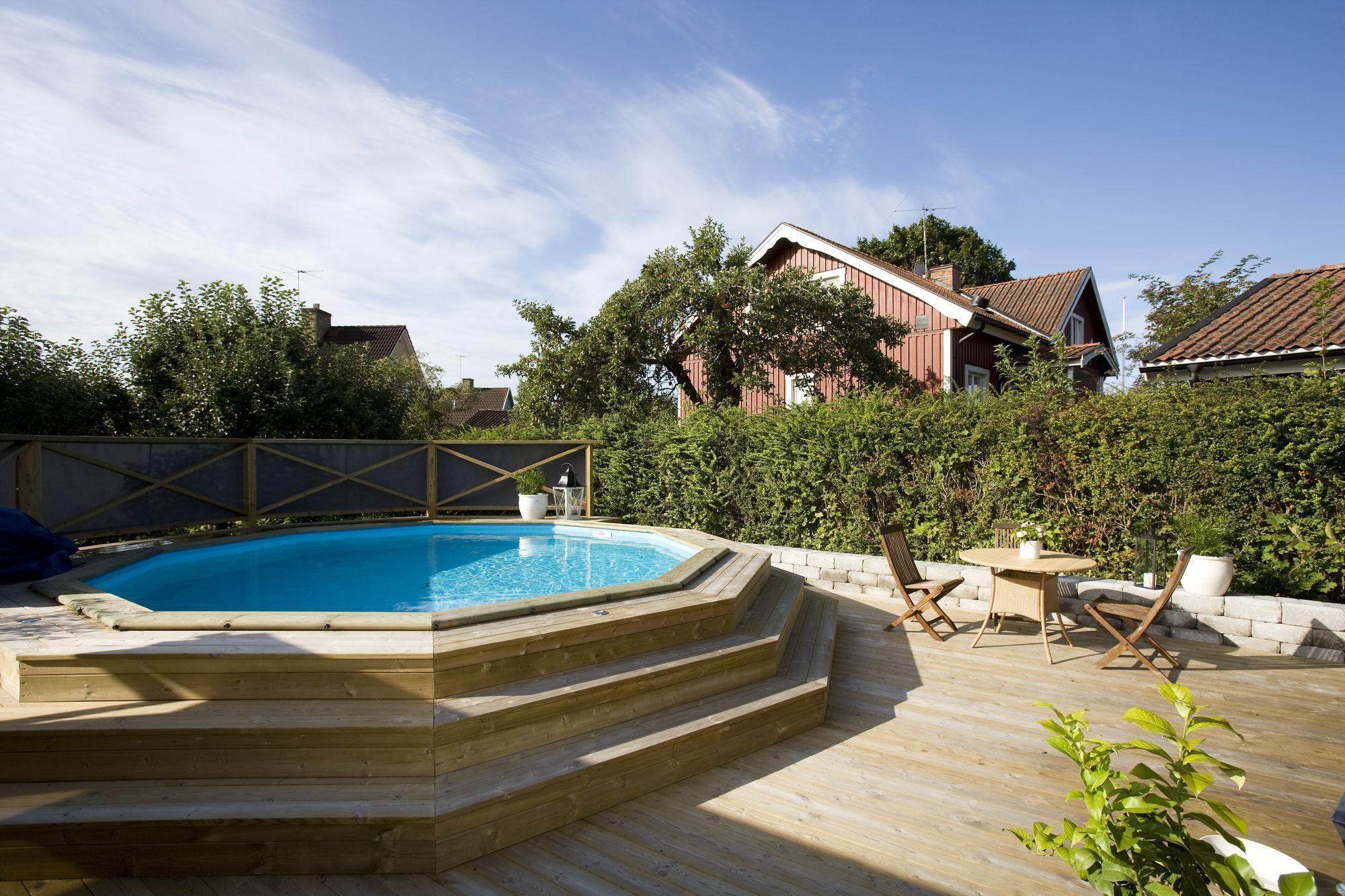 Wood Deck Round Above Ground Pool Buscar Con Google Pool Anlagga Pool Pooldack