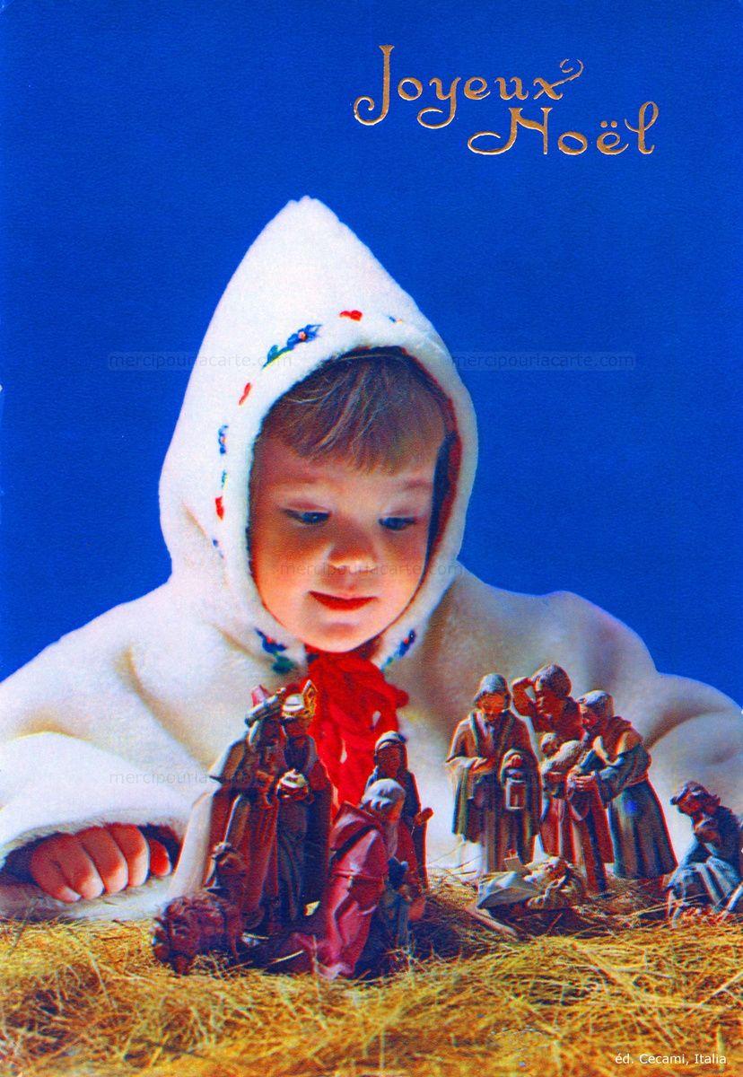 Joyeux Noël - Un enfant dans son manteau blanc et sa capuche contemple les santons d'une crèche de Noël (from http://mercipourlacarte.com/picture?/1455/)
