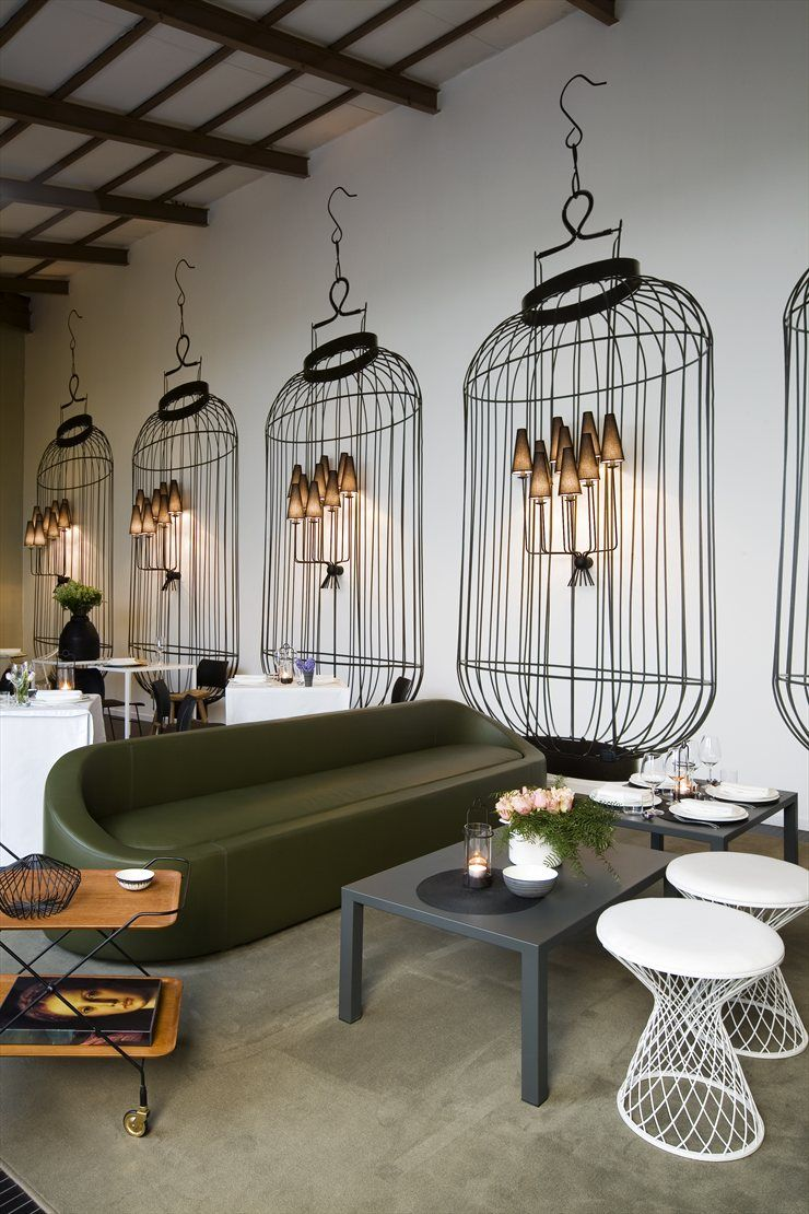 Home delicate restaurant milano 2008 how cool with the painted bird cages around the sconces