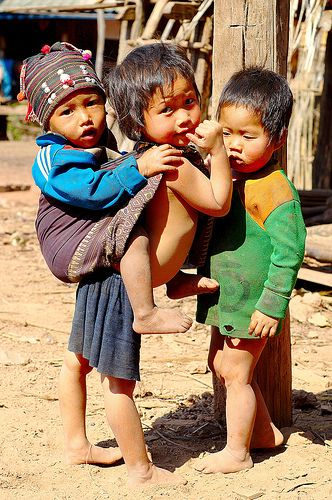 Akha Children. The Akha are an indigenous hill tribe who live in Laos, Burma, Thailand, and the province of Yunnan in China.