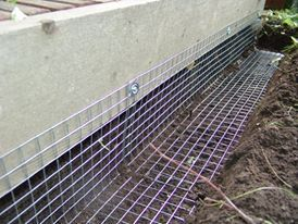 Wildlife proof fencing works for animals that burrow skunks raccoons great for under your How to keep raccoons out of garden