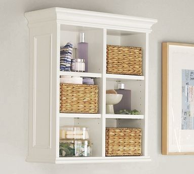 White bathroom wall cabinet with shelf is designed for convenience ...