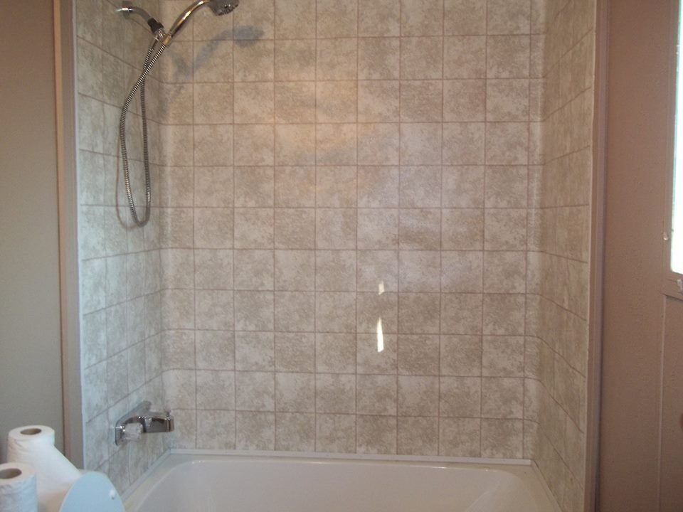 Mobile home bathroom redo. Old bathtub and surround were to gross ...