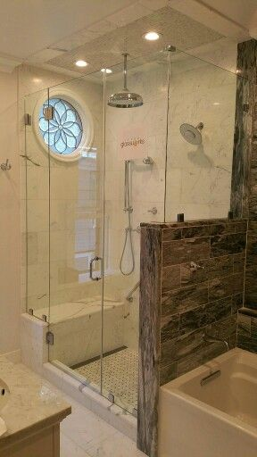 A Very Tall Frameless Shower Door Enclosure Hinged With Both A Glass