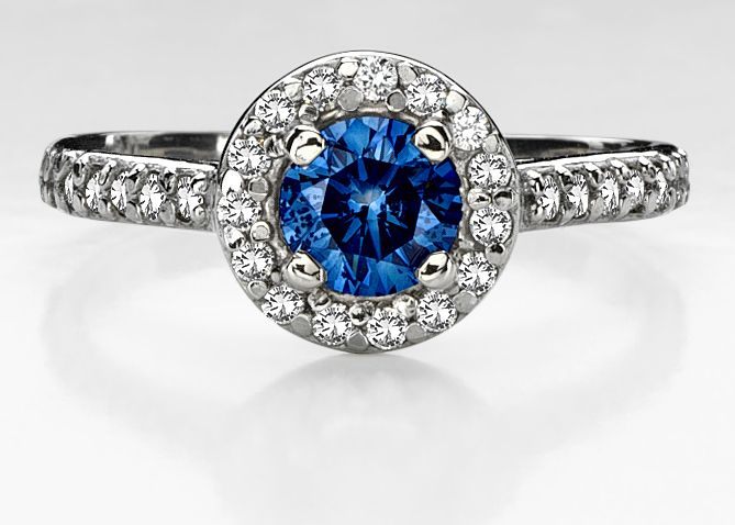 The Blue diamond in this engagement ring would definitely take