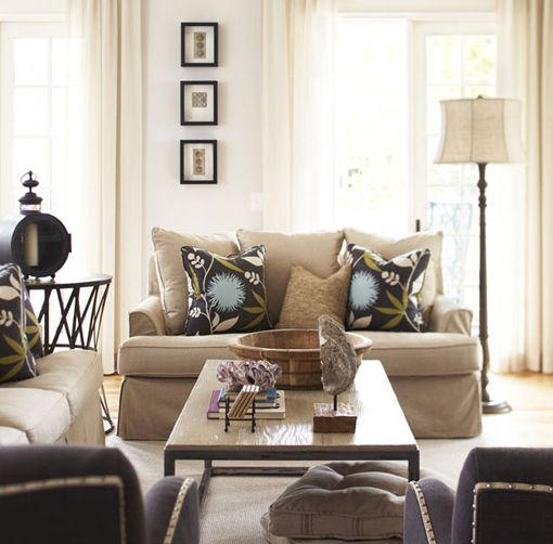 Love the punch of colour and design from the pillows. The rest of the room is really simple.