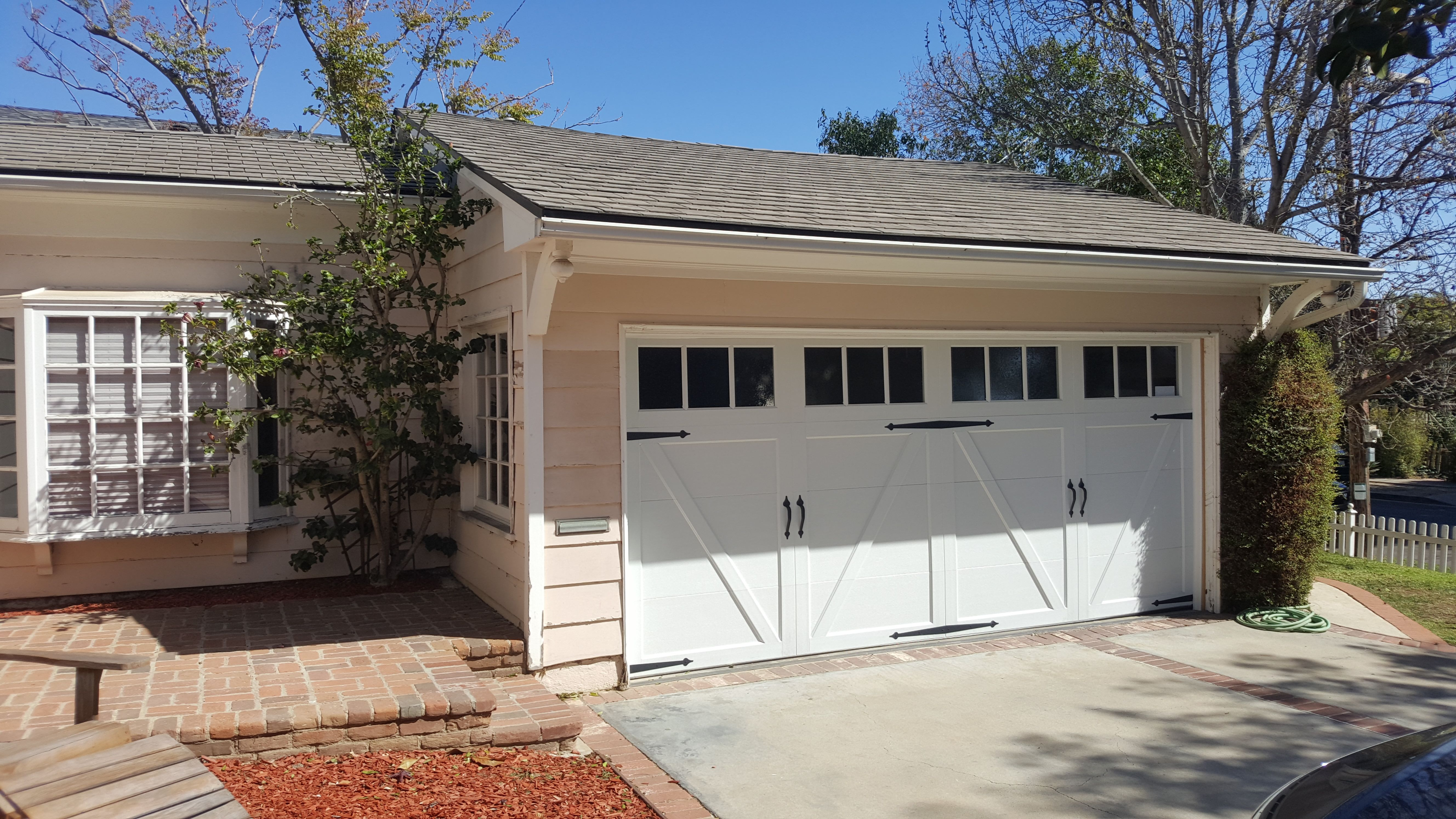 Carriage House Steel Garage Doors Installed In Sherman Oaks Ca Garage Doors Door Installation Steel Garage Doors