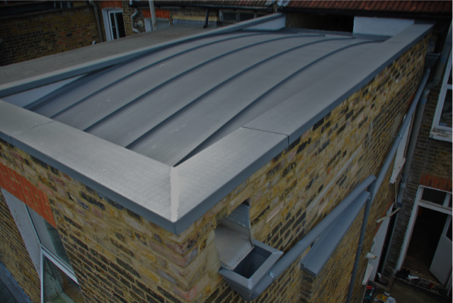 Curved zinc roof with parapet capping box gutters for Parapet roof design pictures