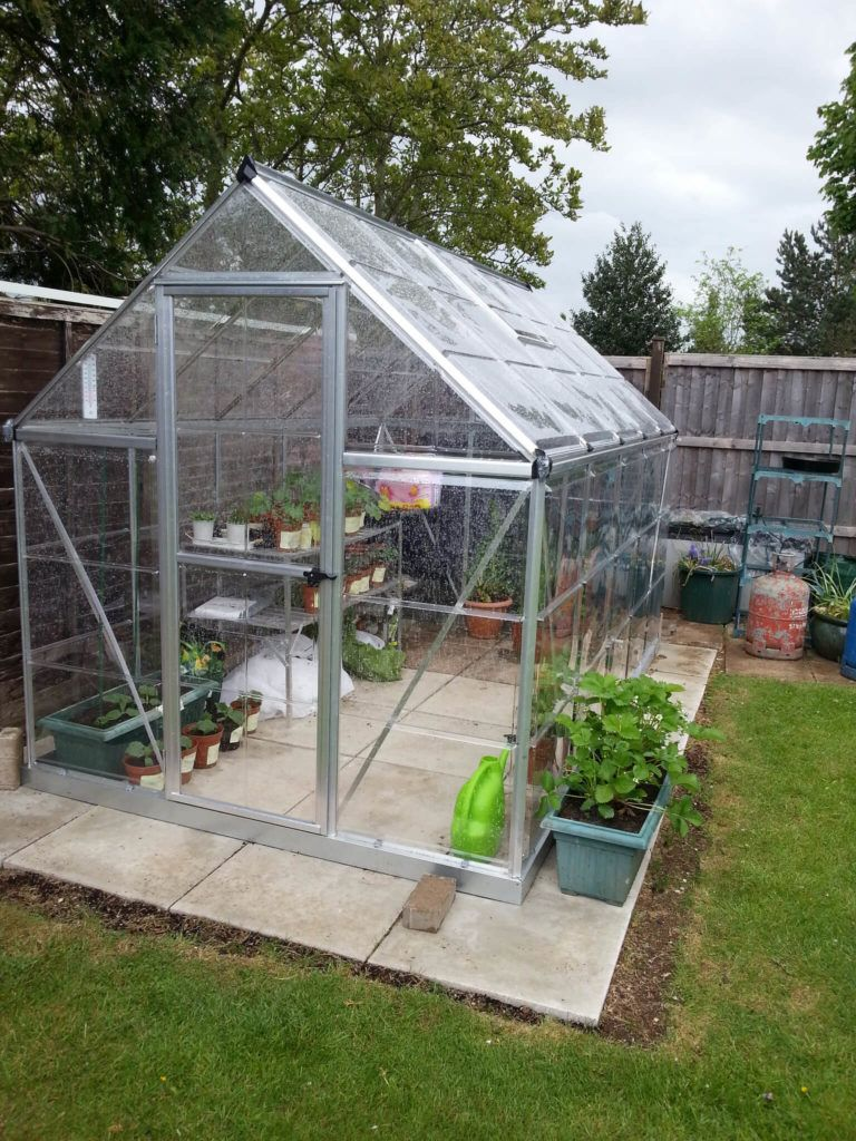 This Is A Small Freestanding Greenhouse On A Stone Stab Out In The Yard This Backyard Greenhouse Greenhouse Outdoor Greenhouse Small backyard greenhouse kit