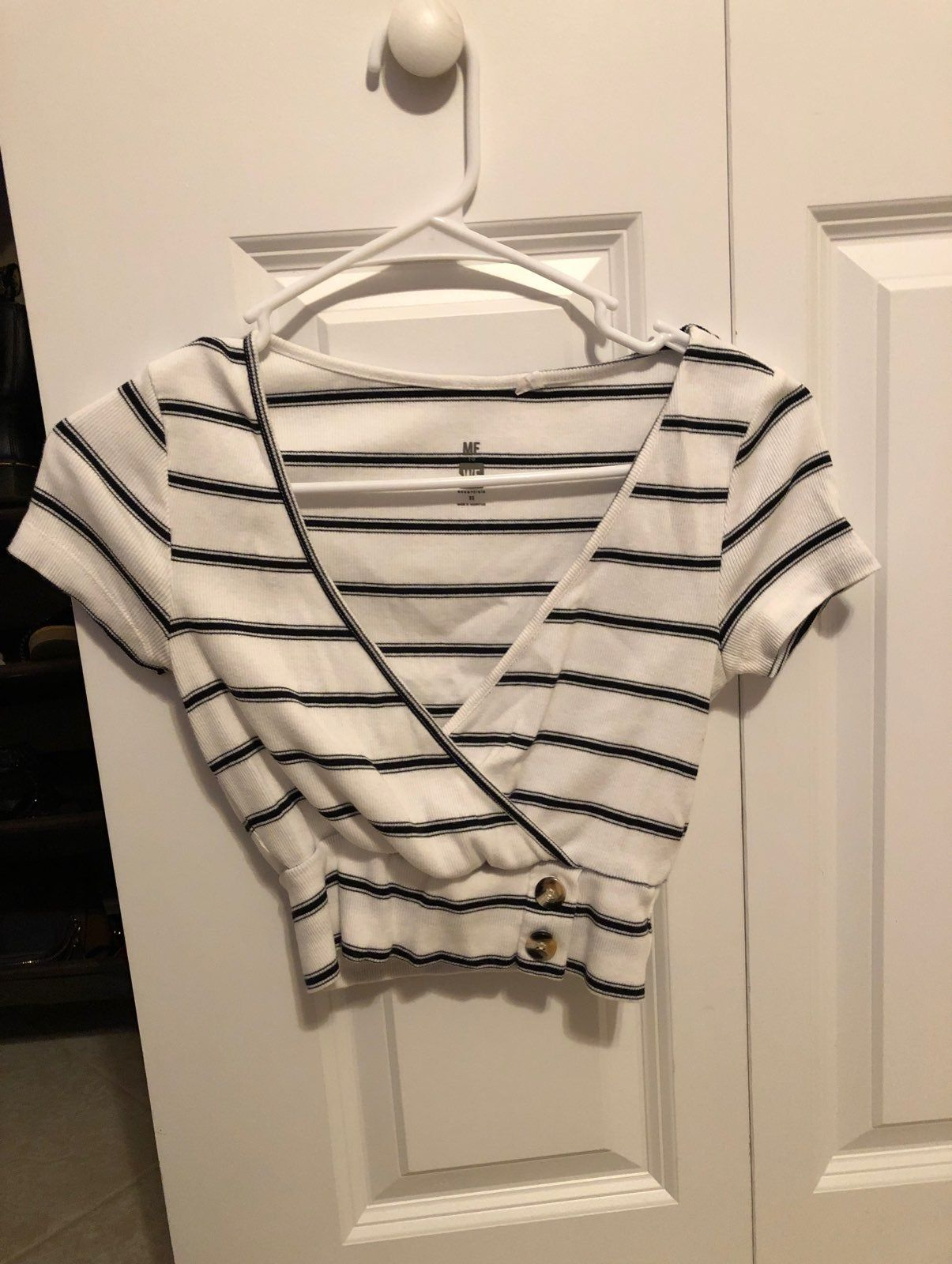 This Striped Black And White Cross Over Top From Brandy Is Super