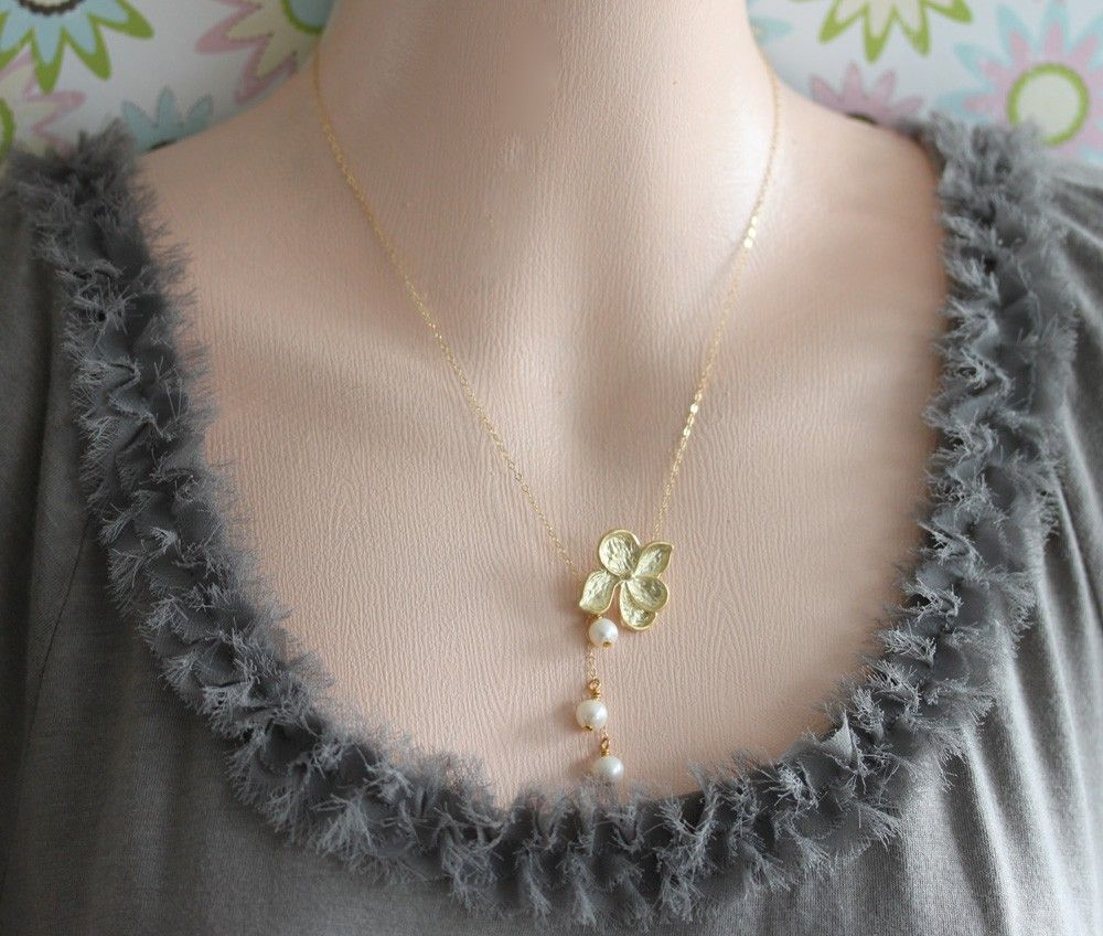 Gold Flower Necklace With Pearls , Pearl Lariat ,  Bridesmaid's Gift. $34.00, via Etsy.