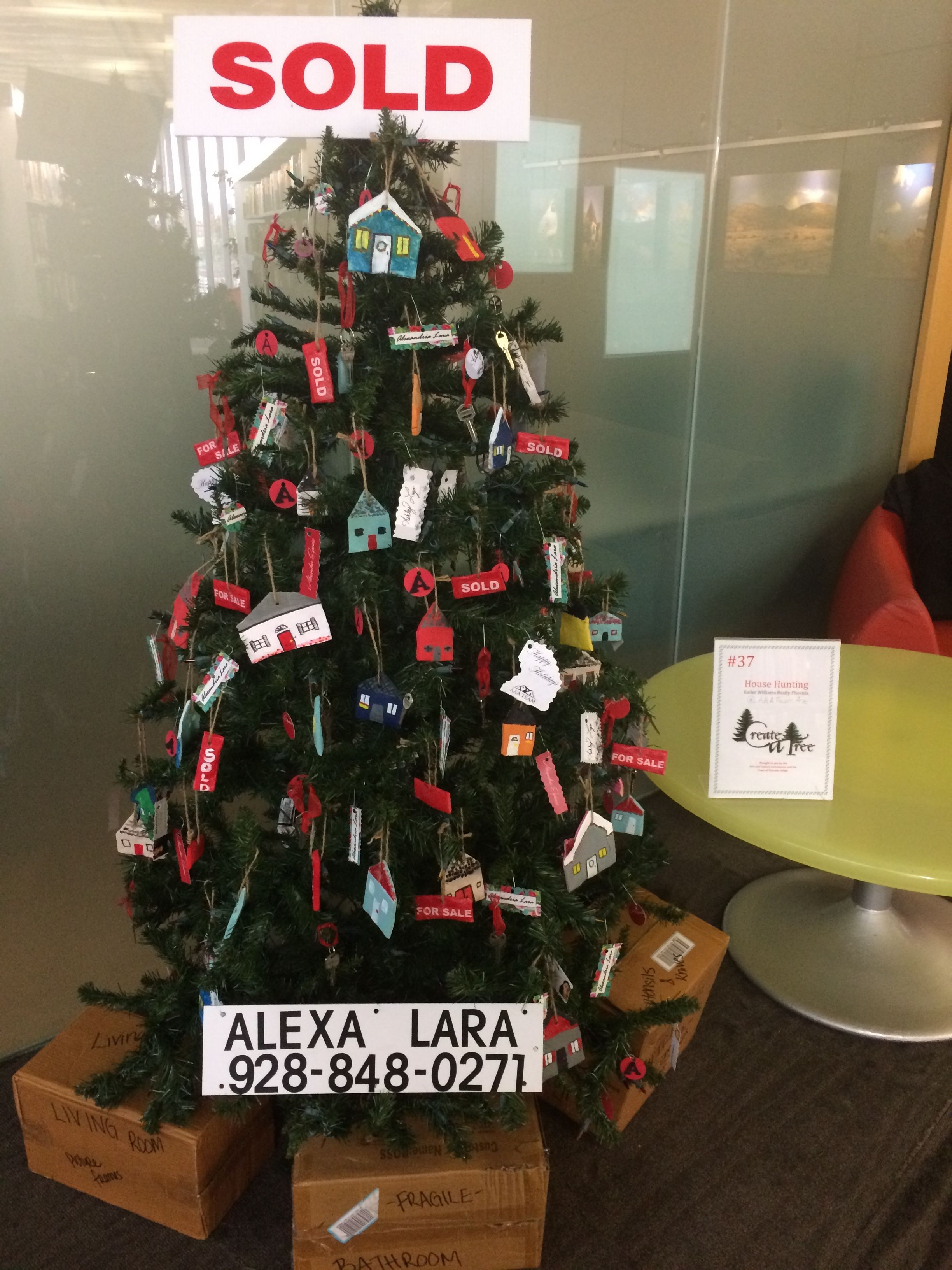 Diy real estate Christmas tree made by AAA Team Az for Create A Tree at the Prescott Valley Event Center. Ornaments made out of salt dough, leftover business cards, miniature houses, house keys, sign riders and moving boxes along the tree base