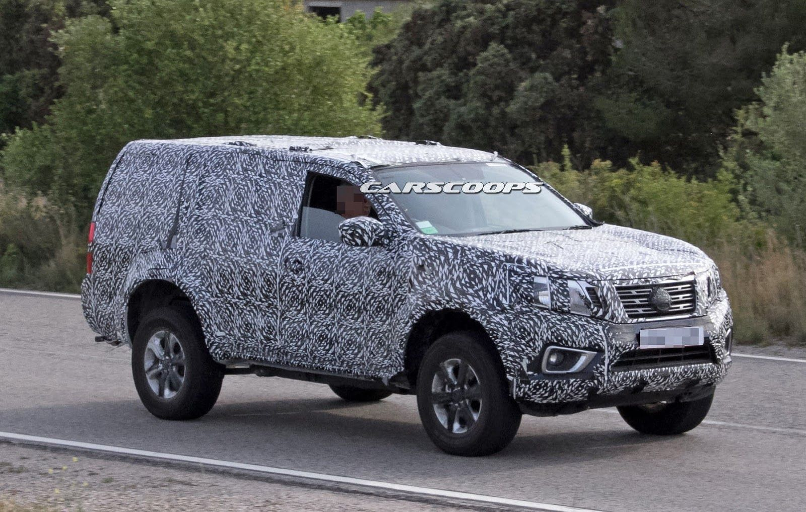 Nissan is readying a tough body on frame suv as our spies nabbed a test mule based on the latest generation navara pickup truck